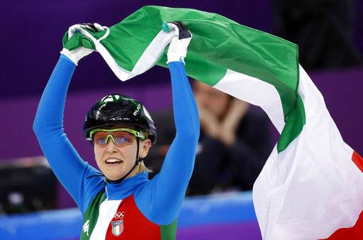 Arianna Fontana of Italy celebrates after winning the ladies' 500 meters short track speedskating final in the Gangneung Ice Arena at the 2018 Winter Olympics in Gangneung, South Korea, Tuesday, Feb. 13, 2018.