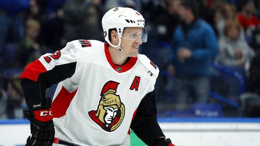 FILE - In this Tuesday, Jan. 23, 2018 file photo, Ottawa Senators' Dion Phaneuf skates during the second period of an NHL hockey game against the St. Louis Blues in St. Louis. The Los Angeles Kings have acquired veteran defenseman Dion Phaneuf from the Ottawa Senators. Phaneuf and forward Nate Thompson go to Los Angeles, which sent forwards Marian Gaborik and Nick Shore to Ottawa. The teams announced the trade Tuesday night, Feb. 13, 2018 after the Senators' loss to the Pittsburgh Penguins.(AP Photo/Jeff Roberson, File)