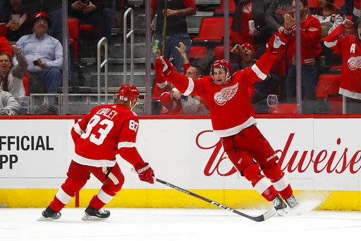 Detroit Red Wings center Dylan Larkin, right, celebrates his goal against the Anaheim Ducks with Trevor Daley (83) in the first period of an NHL hockey game Tuesday, Feb. 13, 2018, in Detroit. (AP Photo/Paul Sancya)