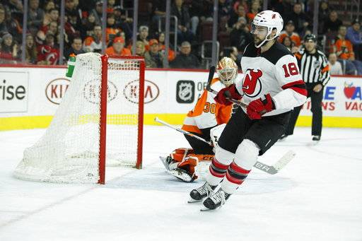 Philadelphia Flyers' Michal Neuvirth looks over his shoulder at the puck in the net after New Jersey Devils' Drew Stafford scored to win the shootout in an NHL hockey game, Tuesday, Feb. 13, 2018 in Philadelphia. The Devils won 5-4. (AP Photo/Tom Mihalek)