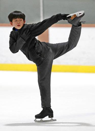 Ten-year-old Keita Horiko practices a move during his second workout of the day Thursday, Feb. 8, 2018, at the Ice House in Hackensack, N.J. At this year's Winter Olympics in Pyeongchang, half of the U.S. figure-skating team is Asian-American. This fact has elevated the hopes of talented skaters like Horiko, who has dreams of one day being an Olympic champion. (AP Photo/Kathy Willens)