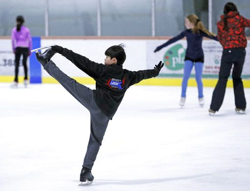 "Keita Horiko, center, the 10-year-old U.S. Figure Skating juvenile boys champion, practices for his new routine Thursday, Feb. 8, 2018, at the Ice House in Hackensack, N.J. ""It's very inspiring and it makes you think, I want to be like them,� Keita said of the Asian-Americans competing on the U.S. team in Olympic figure skating."