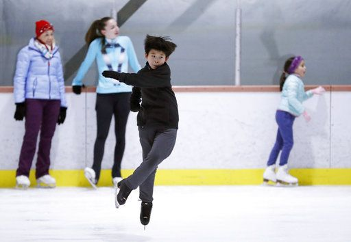 Keita Horiko, the 10-year-old U.S. Figure Skating juvenile boys champion, practices a spin during a workout, his second of the day, at the Ice House, Thursday, Feb. 8, 2018, in Hackensack, N.J. This year half of the U.S.'s 14-member Olympic figure skating team is Asian-American.