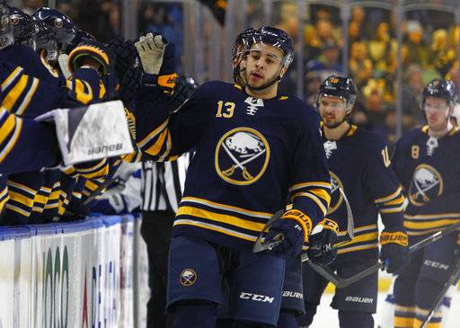 Buffalo Sabres forward Nicholas Baptiste (13) celebrates his goal during the first period of an NHL hockey game against the Tampa Bay Lightning, Tuesday, Feb. 13, 2018, in Buffalo, N.Y. (AP Photo/Jeffrey T. Barnes)