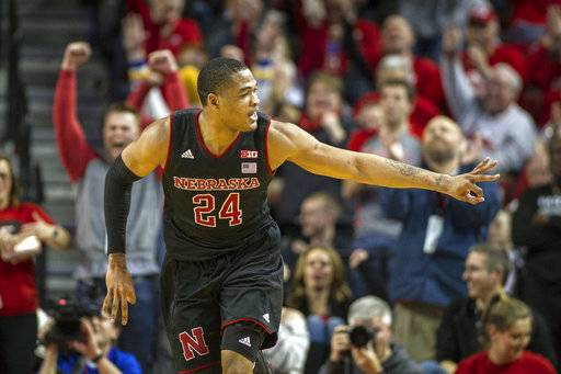 Nebraska's James Palmer Jr. (24) holds up three fingers for after making a three point shot against Maryland during the second half of an NCAA college basketball game in Lincoln, Neb. Tuesday, Feb. 13, 2018. Nebraska beat Maryland 70-66. (AP Photo/John Peterson)