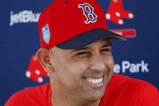 Boston Red Sox manager Alex Cora smiles as he speaks to the media at baseball spring training, Tuesday, Feb. 13, 2018, in Fort Myers, Fla. (AP Photo/John Minchillo)