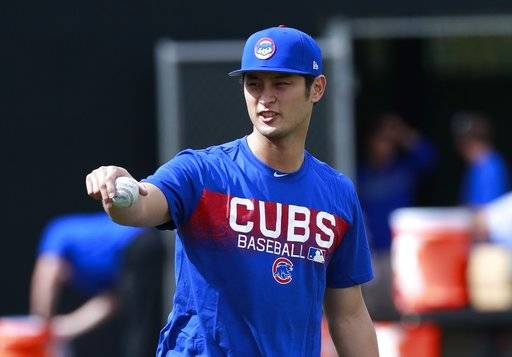 Chicago Cubs starting pitcher Yu Darvish takes a break from warmup pitches at the team's spring training baseball facility Tuesday, Feb. 13, 2018, in Mesa, Ariz. Darvish signed a $126 million, six-year contract over the weekend.