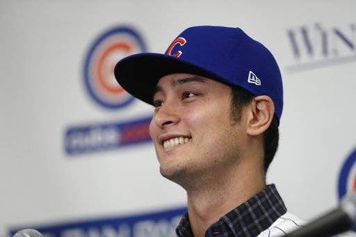 Chicago Cubs starting pitcher Yu Darvish responds during a media availability at the team's spring training baseball facility Tuesday, Feb. 13, 2018, in Mesa, Ariz. Darvish signed a $126 million, six-year contract over the weekend.