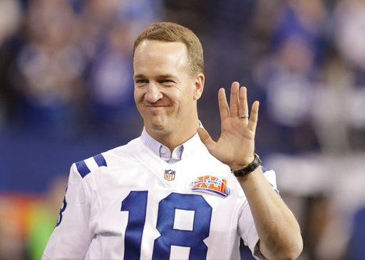 FILE - In this Nov. 20, 2016, file photo, former Indianapolis Colts quarterback Peyton Manning claps as the team honored the 2006 Super Bowl winning team during half time of an NFL football game in Indianapolis. Peyton Manning is leading one more drive on a huge stage. The two-time Super Bowl-winning quarterback will serve as honorary pace car driver for the 60th running of the Daytona 500. (AP Photo/Darron Cummings, File)