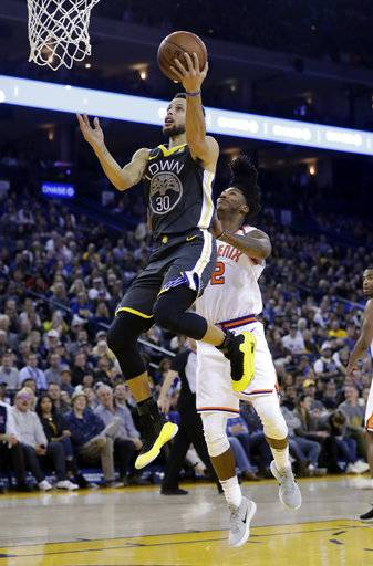 Golden State Warriors' Stephen Curry (30) drives past Phoenix Suns' Elfrid Payton (2) during the first half of an NBA basketball game Monday, Feb. 12, 2018, in Oakland, Calif.
