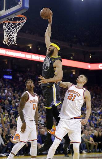 Golden State Warriors' JaVale McGee, center, dunks past Phoenix Suns' Marquese Chriss (0) and Alex Len (21) during the first half of an NBA basketball game Monday, Feb. 12, 2018, in Oakland, Calif.
