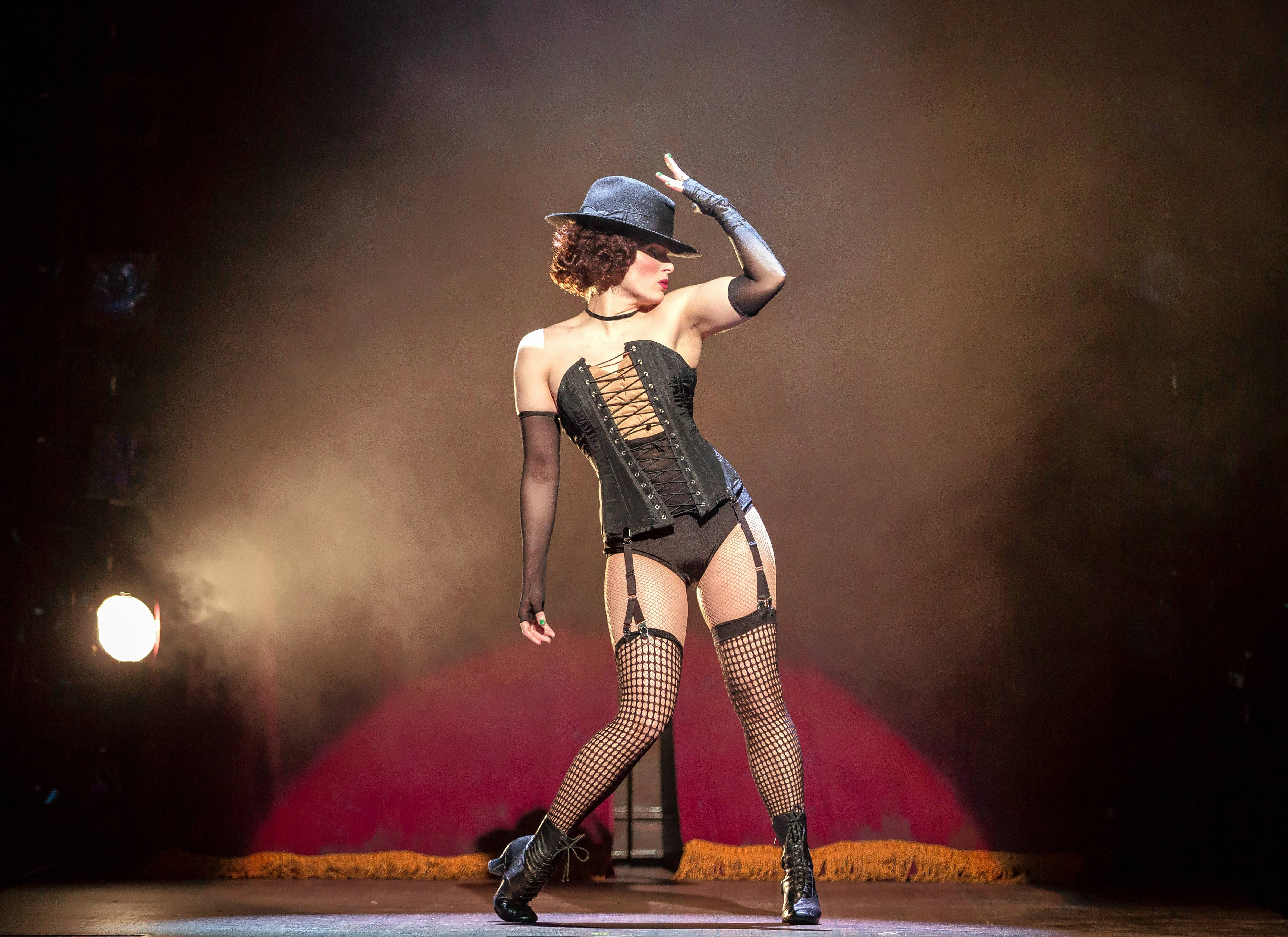 "Sally Bowles (Kelly Felthous) sings the breakup number ""Mein Herr"" in the seedy Kit Kat Klub in ""Cabaret"" at the Paramount Theatre in Aurora."