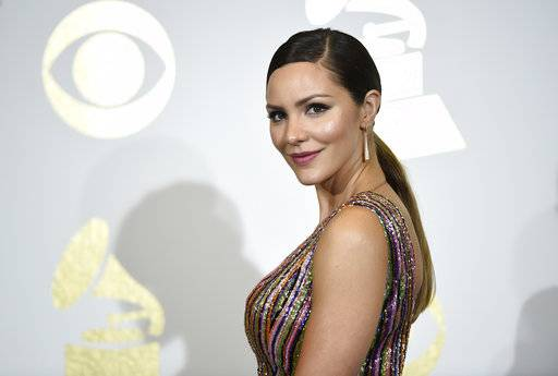 "FILE - In this Feb. 12, 2017 file photo, singer and actress Katharine McPhee poses in the press room at the Grammy Awards in Los Angeles. McPhee, who stars in the CBS series, ""Scorpion,"" will appear in the hit musical ""Waitress,� marking her Broadway debut. She starts April 10.(Photo by Chris Pizzello/Invision/AP, File)"