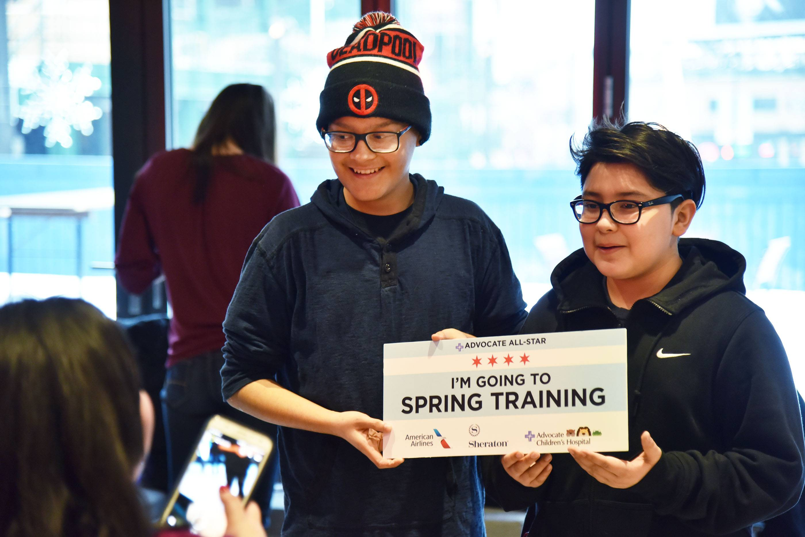 Jonathan Olmos, 16, left, of Des Plaines and his friend Julian Garcia, 12, learned Wednesday at Wrigley Field they were given a free trip to see the Chicago Cubs in spring training in Arizona.