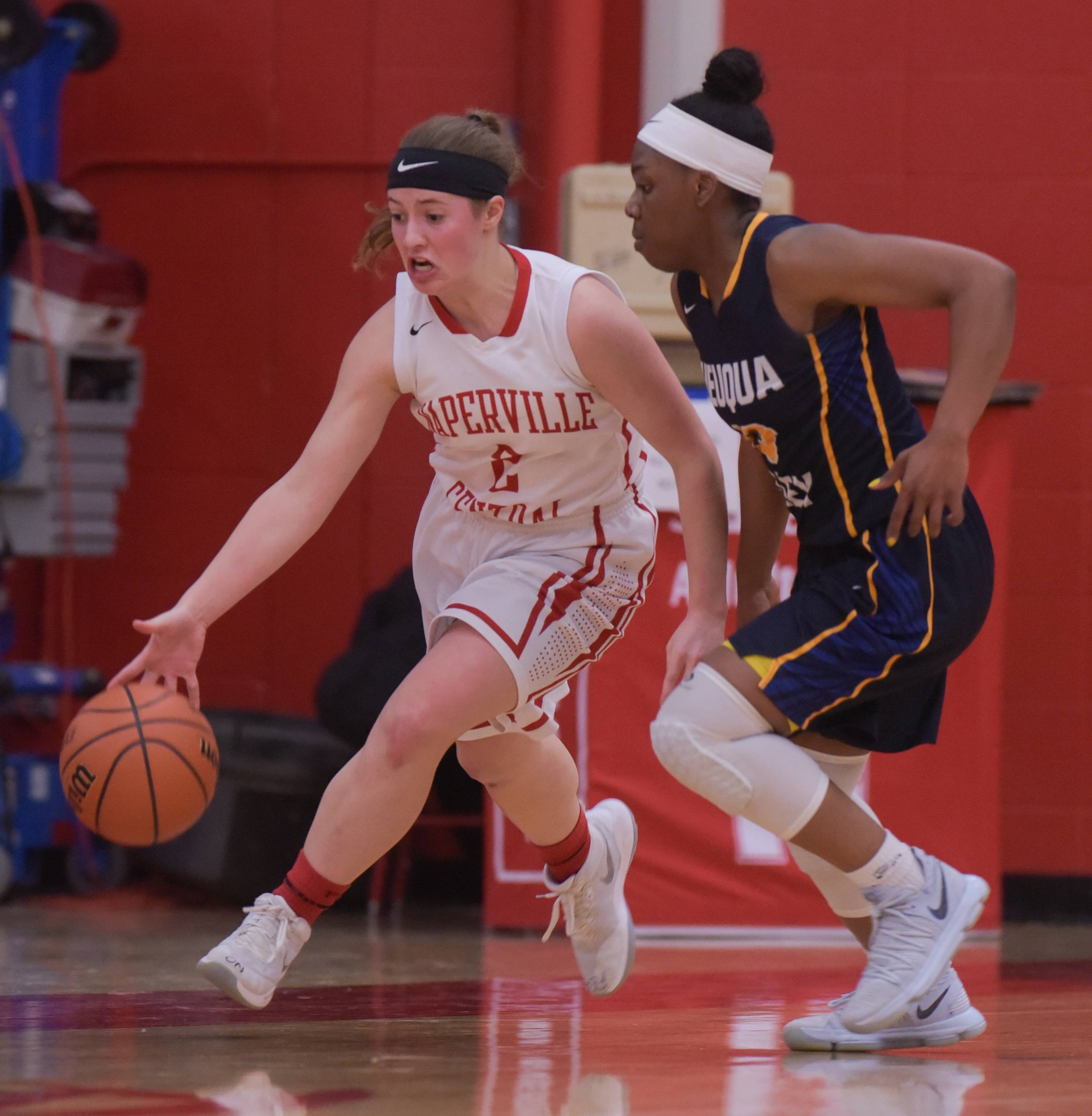 Naperville Central's Gabi Melby (2) moves the ball down the court past Neuqua Valley's Jada Harvey (13) during the Class 4A girls basketball regional semifinals at Naperville Central on February 14, 2018.