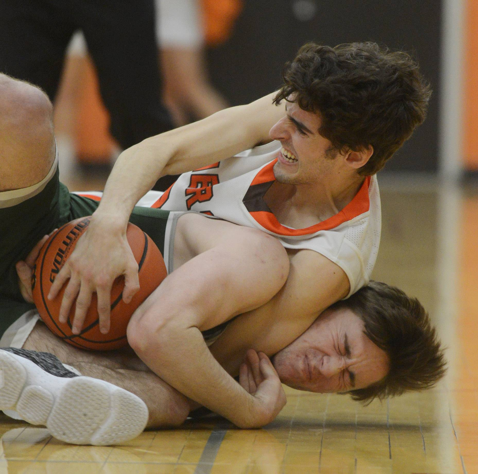 Hersey's Will Nagle, top, fouls Grayslake Central's Clay Stoffel as they go to the floor for a loose ball during Wednesday's game in Arlington Heights.