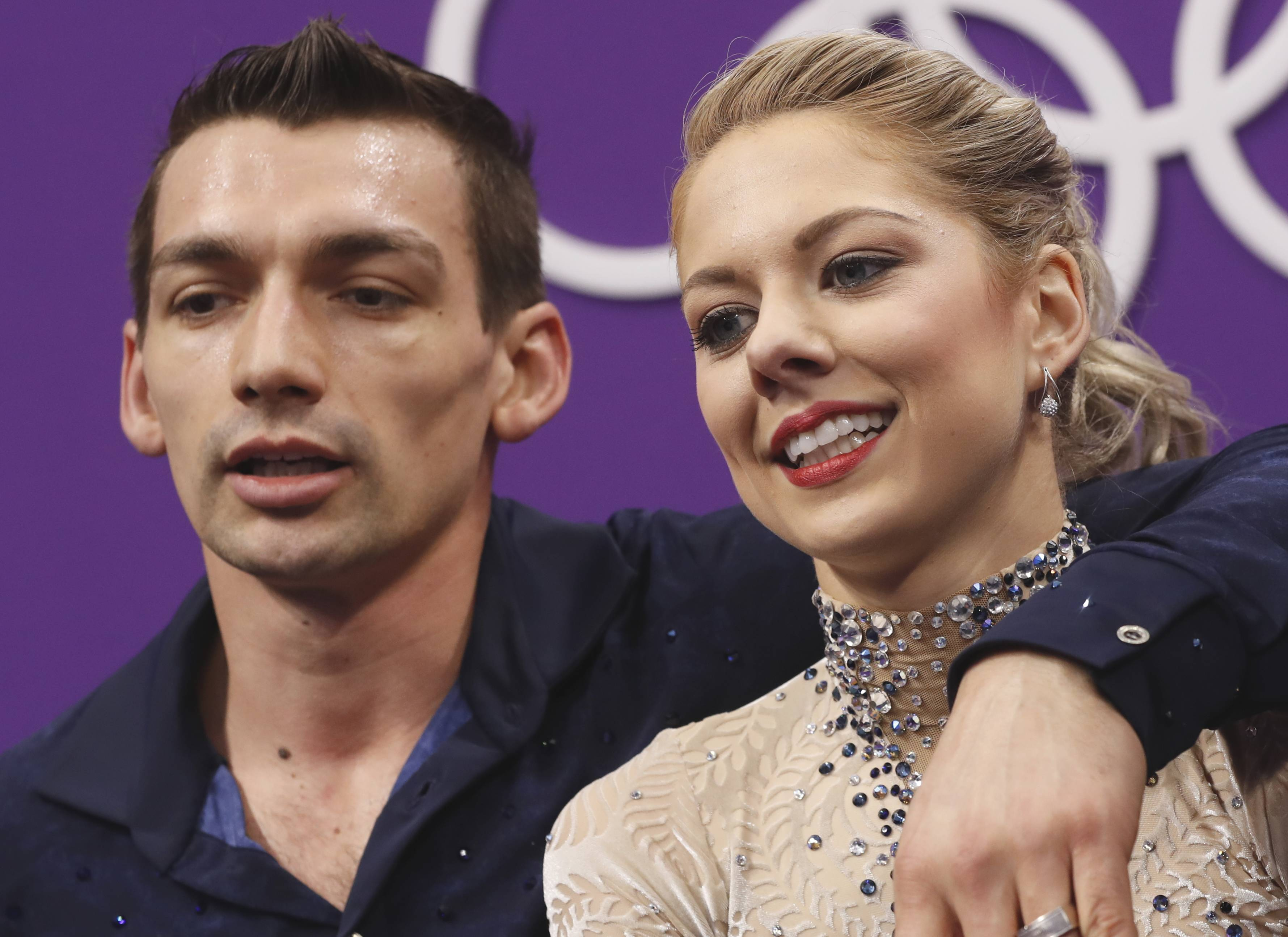 Alexa Scimeca Knierim and Chris Knierim of the USA react as they wait for their scores to be posted following their performance in the pair figure skating short program in the Gangneung Ice Arena at the 2018 Winter Olympics in Gangneung, South Korea, Wednesday, Feb. 14, 2018.