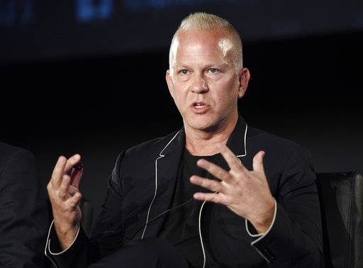 "FILE - In this Aug. 9, 2017 file photo, Ryan Murphy, the executive producer/writer/director of ""The Assassination of Gianni Versace: American Crime Story,"" takes part in a panel discussion on the FX series during the 2017 Television Critics Association Summer Press Tour in Los Angeles. Murphy is expanding his empire to Netflix. The streaming service says Murphy signed a deal to produce new series and films exclusively for it starting in July. (Photo by Chris Pizzello/Invision/AP, File)"