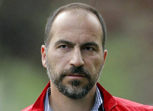 FILE - In this July 13, 2012, file photo, Expedia CEO Dara Khosrowshahi attends the Allen & Company Sun Valley Conference in Sun Valley, Idaho. Ride-hailing giant Uber's full-year net loss widened to $4.5 billion in 2017. The results also showed that Uber cut its fourth-quarter net loss by 25 percent from the third quarter as new CEO Khosrowshahi moves to make the company profitable ahead of a planned initial public stock offering sometime next year.
