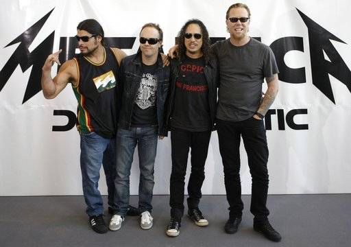 "FILE - This is a Friday, Sept. 12, 2008 file photo of member of rock backs Metallica Robert Trujillo, Lars Ulrich, Kirk Hammett and James Hetfield, from left, as they pose for the media while promoting their new album 'Death Magnetic' in Berlin. American heavy metal band Metallica and Afghanistan's National Institute of Music it was announced Wednesday Feb. 14, 2018 have won the 2018 Polar Music Prizes, a Swedish award. It is the first time a heavy metal band gets an award given each year for significant achievements in music. The award panel said Metallica has taken rock music ""to places it had never been before"" and that the Afghan music institute ""shows you can transform lives through music."" (AP Photo/Miguel Villagran/File)"