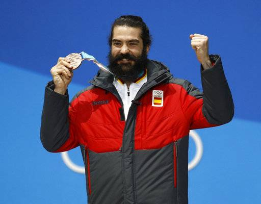 Bronze medalist in the men's snowboard cross Regino Hernandez, of Spain, celebrates during the medals ceremony at the 2018 Winter Olympics in Pyeongchang, South Korea, Thursday, Feb. 15, 2018. (AP Photo/Patrick Semansky)