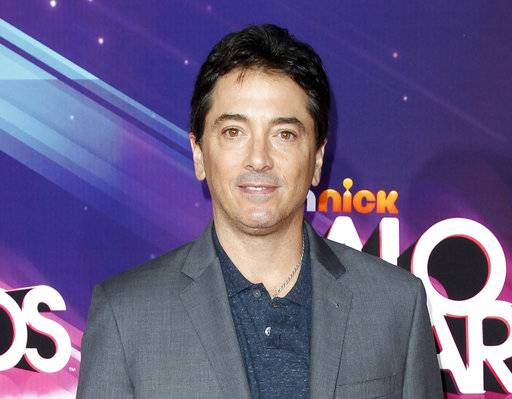 "FILE - In this Nov. 17, 2012 file photo, actor Scott Baio arrives at the TeenNick HALO Awards in Los Angeles. Former ""Charles in Charge� actor Alexander Polinsky says Baio assaulted and ""mentally tortured� him during their time together on the show in the 1980s. Polinsky made the allegations Wednesday, Feb. 14, 2018, in Los Angeles during a news conference called by his attorney. (Photo by Joe Kohen/Invision/AP, File)"