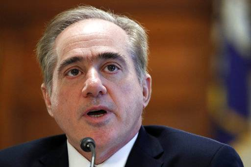 File - In this Feb. 6, 2018 file photo, Veterans Affairs Secretary David Shulkin speaks during a House Committee on Veterans' Affairs hearing on veteran caregiver support on Capitol Hill in Washington. An internal watchdog's investigation has found that Veterans Affairs Secretary David Shulkin improperly accepted Wimbledon tennis tickets and likely wrongly used taxpayer money to cover his wife's airfare for an 11-day European trip. (AP Photo/Jacquelyn Martin)