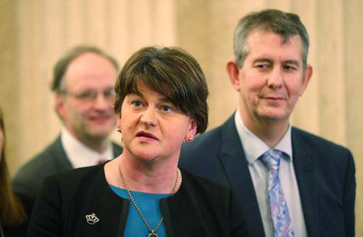 DUP's Arlene Foster speaks to the media at Stormont Parliament buildings in Belfast, Northern Ireland, Monday Feb. 12, 2018, as Prime Minister Theresa May and her Irish counterpart Leo Varadkar are holding crunch talks at Stormont House. Northern Ireland's Catholic-Protestant power-sharing government has been suspended since January 2017, but with renewed high lefel talks both sides said Monday that progress has been made.(Niall Carson/PA via AP)