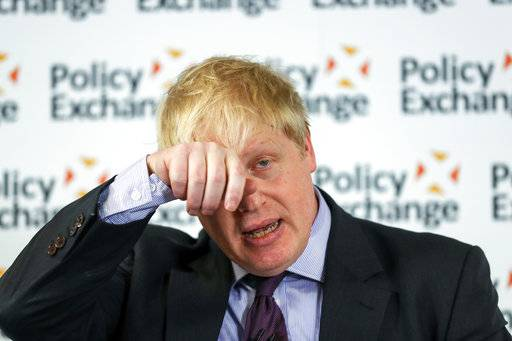 "Britain's Foreign Secretary Boris Johnson wipes his forehead as he delivers a speech at the Policy Exchange in London, Wednesday Feb. 14, 2018. The Foreign Office says Johnson will use a speech Wednesday to argue for ""an outward-facing, liberal and global Britain"" after the U.K. leaves the bloc. (Simon Dawson/Pool via AP)"