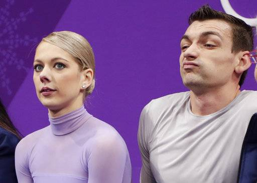 Alexa Scimeca Knierim and Chris Knierim of the USA react as their scores are posted following their performance in the pairs free skate figure skating final in the Gangneung Ice Arena at the 2018 Winter Olympics in Gangneung, South Korea, Thursday, Feb. 15, 2018. (AP Photo/Julie Jacobson)