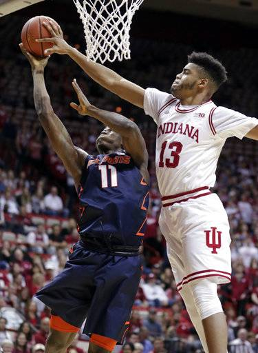 Indiana forward Juwan Morgan (13) blocks the shot of Illinois forward Greg Eboigbodin (11) during the first half of an NCAA college basketball game in Bloomington, Ind., Wednesday, Feb. 14, 2018. (AP Photo/Michael Conroy)