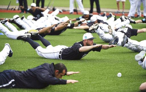 Detroit Tigers pitcher Alex Wilson does an exercise with the rest of the players during spring baseball practice, Wednesday, Feb. 14, 2018 in Lakeland, Fla. (Robin Buckson/Detroit News via AP)