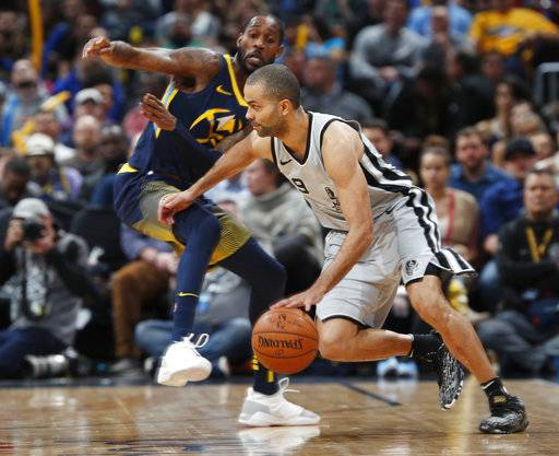 San Antonio Spurs guard Tony Parker, front, drives past Denver Nuggets guard Will Barton during the first half of an NBA basketball game Tuesday, Feb. 13, 2018, in Denver.