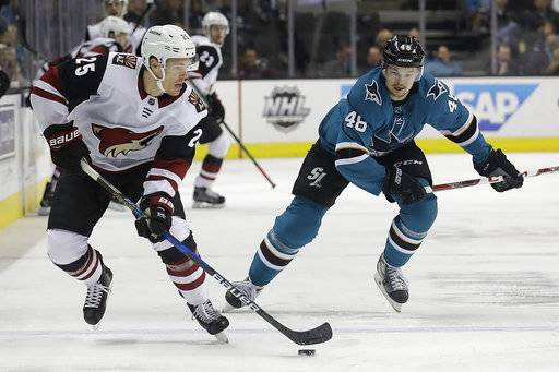 Arizona Coyotes center Nick Cousins (25) skates in front of San Jose Sharks center Tomas Hertl (48), from the Czech Republic, during the first period of an NHL hockey game in San Jose, Calif., Tuesday, Feb. 13, 2018.