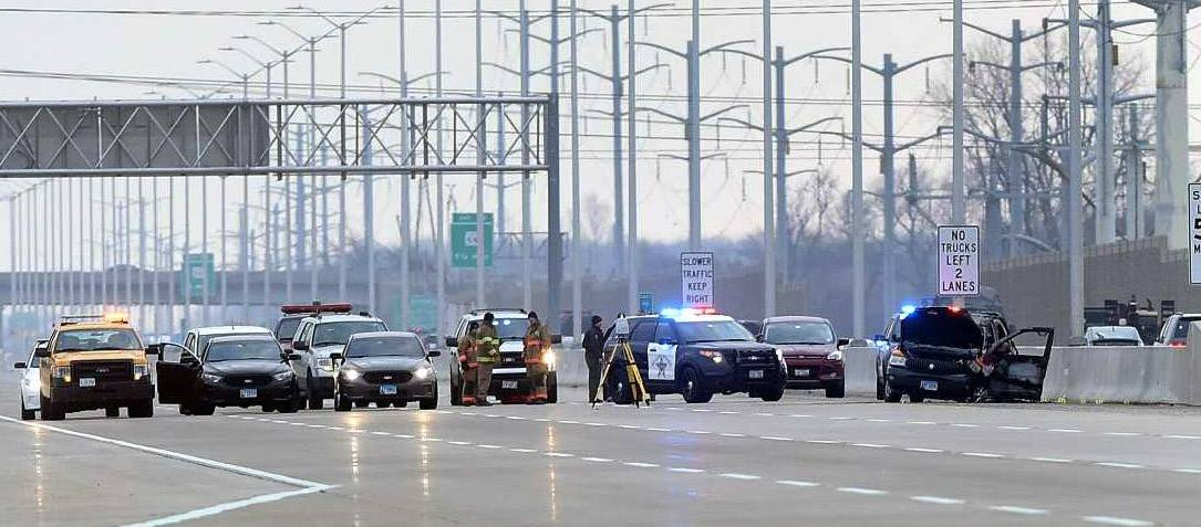 Police continue to investigate an officer-involved shooting Monday morning on Interstate 90 near Route 25 in Elgin. A 34-year-old Elgin woman died in the shooting.