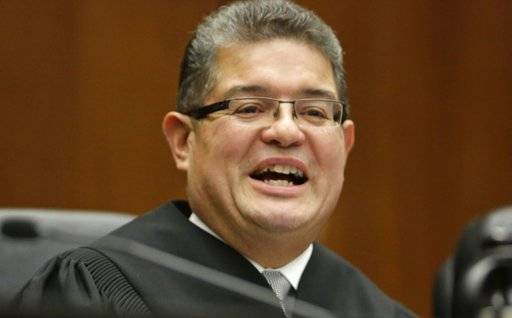 FILE - In this Nov. 25, 2013 file photo, Chief U.S. District Judge Ruben Castillo speaks from the bench in Chicago. Castillo is slated to issue a first-in-the-nation ruling Monday, March 12, 2018, about whether law enforcement stings where suspects are talked into robbing non-existent drugs from non-existent stash houses are racially biased.