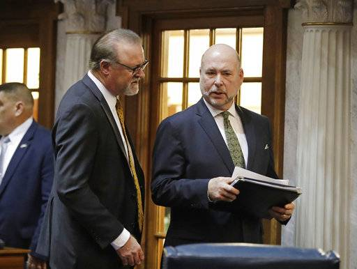 Republican Senate leader David Long of Fort Wayne speaks with House Speaker Brian Bosma, R- Indianapolis during a recess at the Statehouse, Wednesday, March 14, 2018, in Indianapolis.