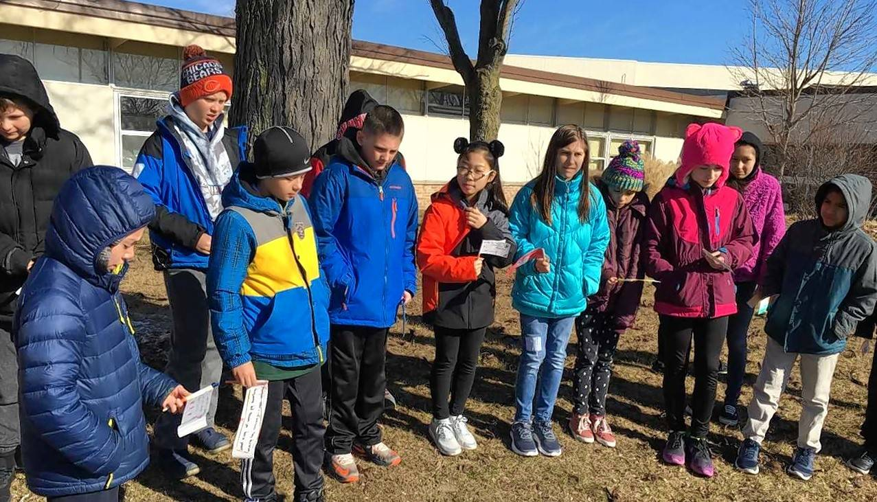 Students at Winston Campus Elementary School in Palatine participate in Wednesday's nationwide school walkout in support of increased gun safety on campuses.