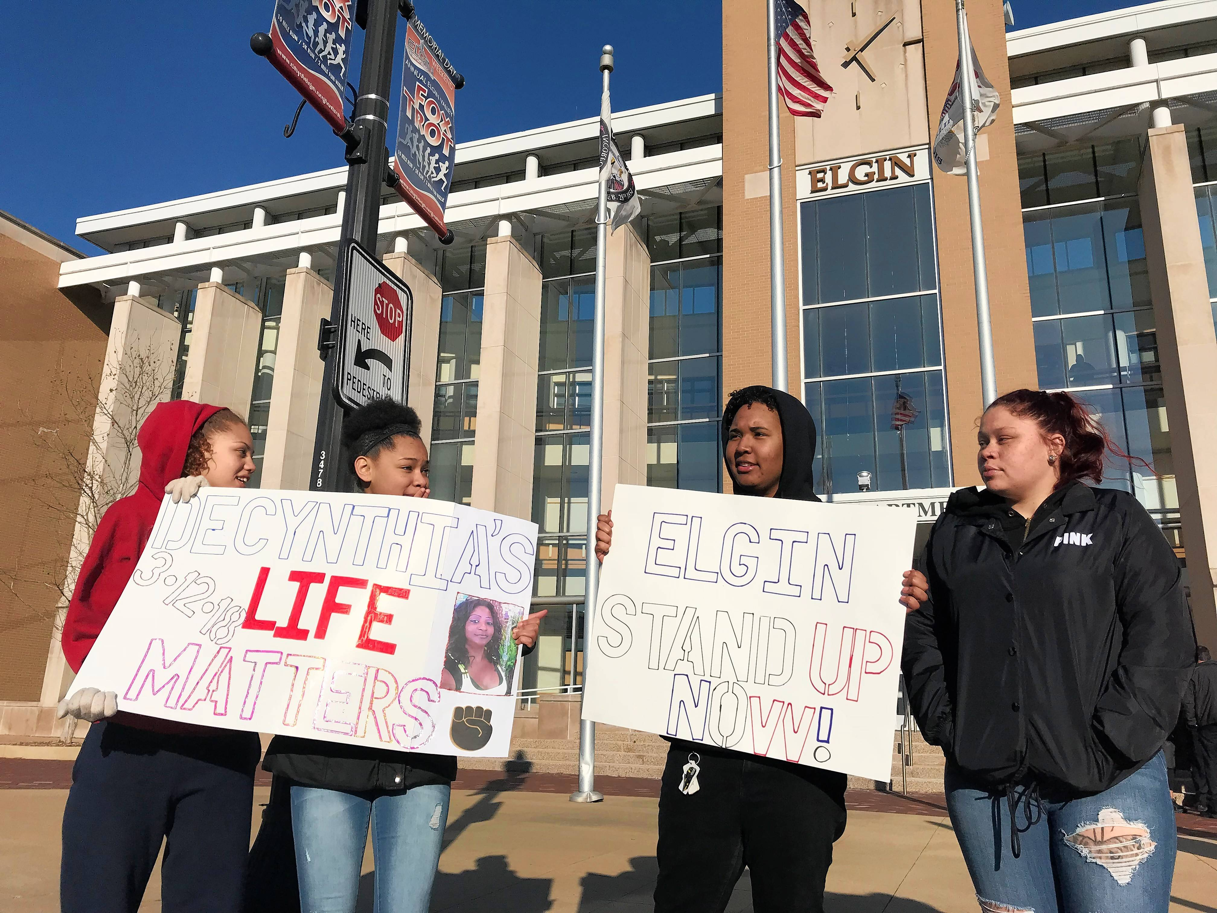 South Elgin High School students Amarrah Banner, far left, and Nadya Quezada, second from right, joined a second day of protests in Elgin demanding the release of police body camera video in the fatal shooting of Decynthia Clements.