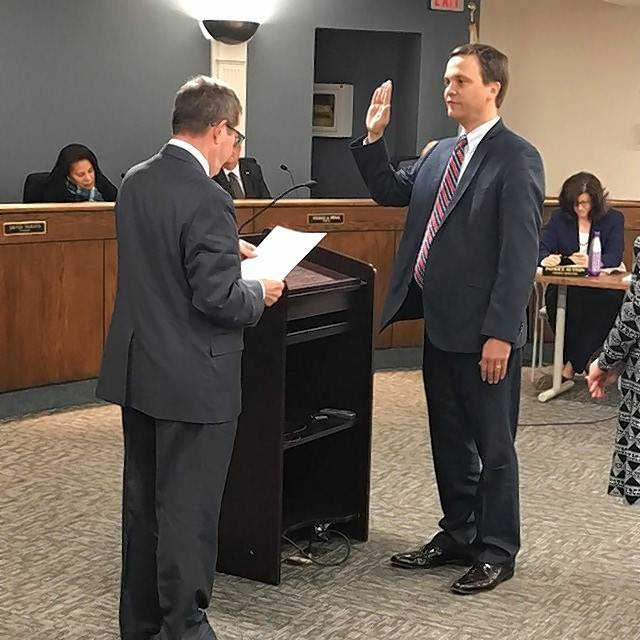 Former Libertyville Village Administrator Christopher Clark, right, is sworn in by Mayor Terry Weppler in late 2016. Clark's resignation became effective Wednesday.