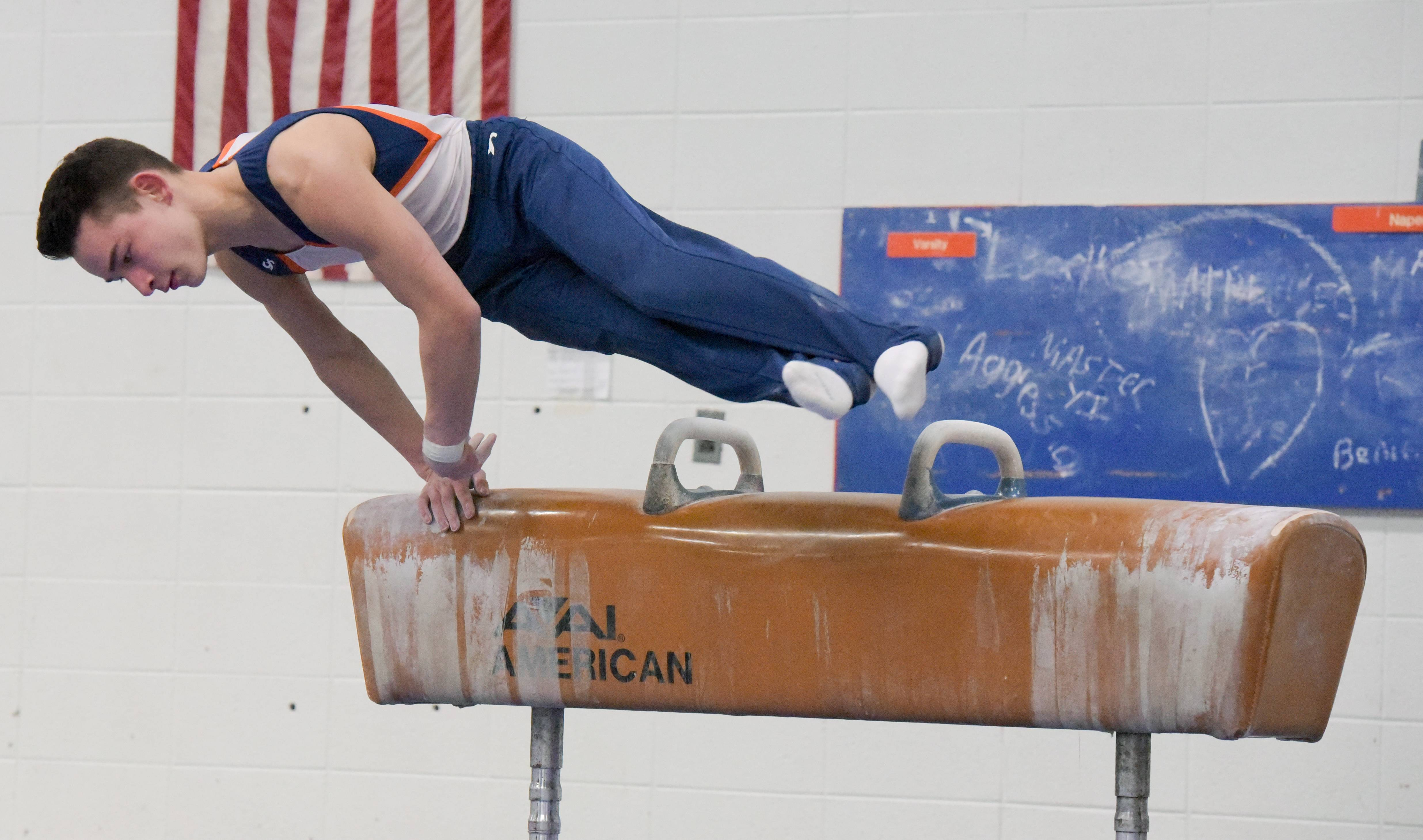 Naperville North's Eric Loid competes on the Pommel Horse against Naperville Central during boys gymnastics on Wednesday, March 14, 2018.