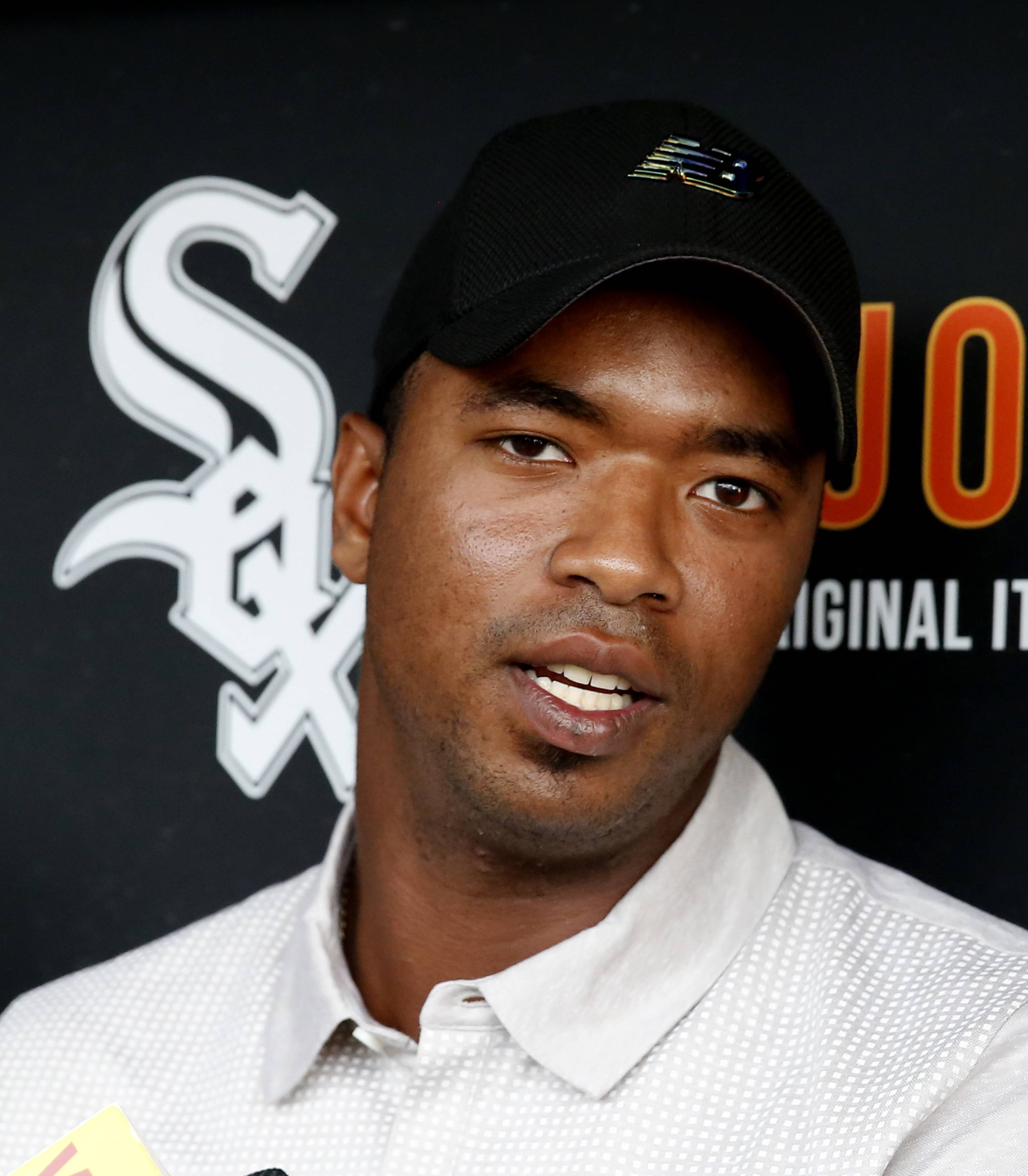 Eloy Jimenez, an outfielder with the Birmingham Barons, a Double-A affiliate of the Chicago White Sox, talks with reporters before a baseball game between the White Sox and the Cleveland Indians on Tuesday, Sept. 5, 2017, in Chicago. (AP Photo/Charles Rex Arbogast)