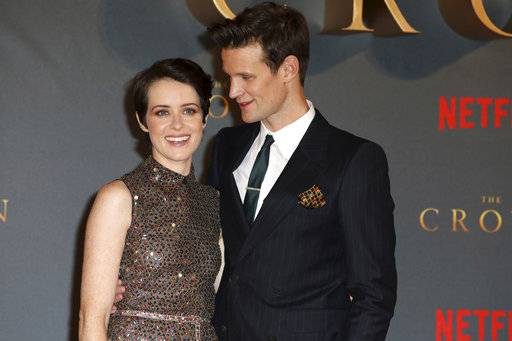"FILE - In this Tuesday, Nov. 21, 2017 file photo, actors Claire Foy, left, and Matt Smith pose for photographers on arrival at the premiere of series 'The Crown, Season 2' in central London. A producer of hit royal drama ""The Crown"" says Claire Foy, who played the central role of Queen Elizabeth II, was paid less than her on-screen husband. Trade publication Variety on Tuesday March 13, 2018 quoted producer Suzanne Mackie as confirming Foy was paid less than Matt Smith, who played Prince Philip in two seasons of the series. (Photo by Grant Pollard/Invision/AP, File)"