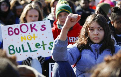 Students sit in silence as they rally in front of the White House in Washington, Wednesday, March 14, 2018. Students walked out of school to protest gun violence in the biggest demonstration yet of the student activism that has emerged in response to last month's massacre of 17 people at Florida's Marjory Stoneman Douglas High School. (AP Photo/Carolyn Kaster)