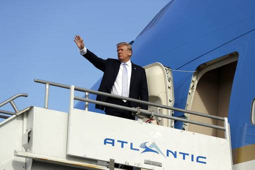 President Donald Trump boards Air Force One at Los Angeles International airport, Wednesday March 14, 2018, in Los Angeles. (AP Photo/Evan Vucci)