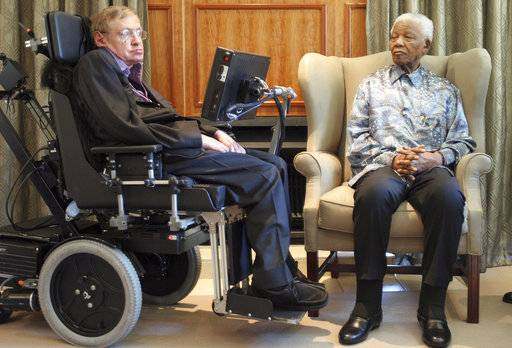 FILE - In this Thursday, May 15, 2008 file photo former South African President Nelson Mandela, right, meets with British scientist Professor Stephen Hawking, left, in Johannesburg. Hawking, whose brilliant mind ranged across time and space though his body was paralyzed by disease, has died, a family spokesman said early Wednesday, March 14, 2018.
