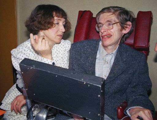FILE - In this March 3, 1989 file photo British astrophysicist Dr. Stephen Hawking, 47, answers newsmen with the help of his computer and the assistance of his then wife Jane, in Paris. Hawking, who has a motor neuron disease communicates with the help of a voice-equipped computer. Hawking, whose brilliant mind ranged across time and space though his body was paralyzed by disease, has died, a family spokesman said early Wednesday, March 14, 2018.