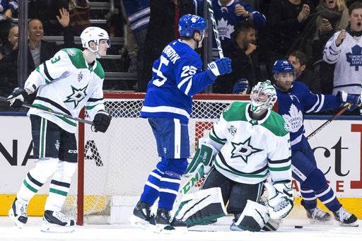 Dallas Stars goaltender Kari Lehtonen (32) looks up at Toronto Maple Leafs left wing James van Riemsdyk (25), who had scored for a hat trick, during the third period of an NHL hockey game Wednesday, March 14, 2018, in Toronto. (Chris Young/The Canadian Press via AP)