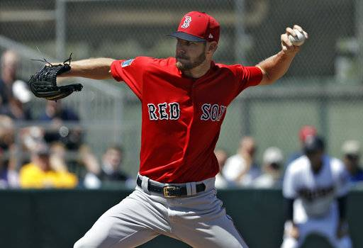 Boston Red Sox starting pitcher Chris Sale delivers to the Minnesota Twins during the first inning of a spring training baseball game Wednesday, March 14, 2018, in Fort Myers, Fla. (AP Photo/Chris O'Meara)