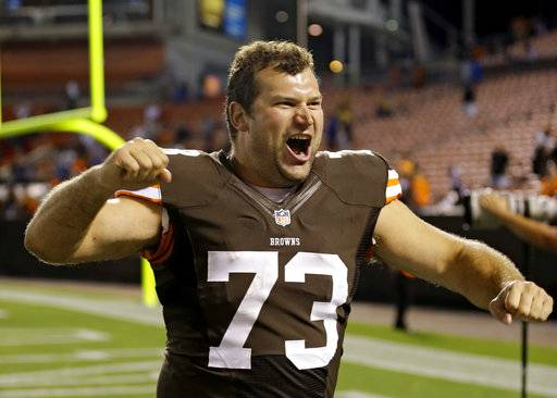 FILE - In this Aug. 15, 2013, file photo, Cleveland Browns tackle Joe Thomas celebrates after a 24-6 win over the Detroit Lions in a preseason NFL football game, in Cleveland. Browns star left tackle Joe Thomas has retired after 11 seasons in the NFL, ending a career in which he exemplified durability, dependability and dominance. A 10-time Pro Bowler, Thomas announced his decision Wednesday, March 14, 2018, after spending several months contemplating whether to come back following a season-ending injury.(AP Photo/Tony Dejak, File)